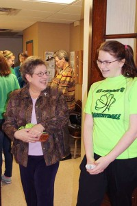 Sister Paula Damiano shares a moment with a student at St. Patrick School.
