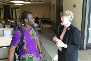 Sister Mary Montgomery speaks with Indiana State University student Kirk Owusu Moore.