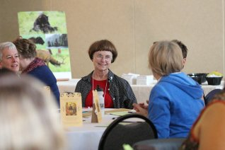 Sister of Providence Ellen Kehoe in discussion with those at her table during the retreat.