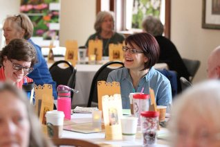 Providence Associate Jessi Blessinger laughs during table discussion.