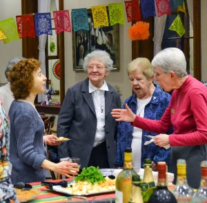 Blog post author Sabrina Falls, left, gets to know some classic Sisters of Providence during a social at the Providence Associate spring retreat in March. From second to left, Sisters Barbara Doherty, Nancy Nolan and Ellen Cunningham.