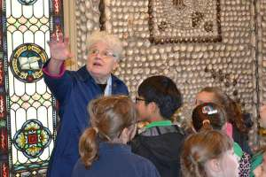Sister Rosemary tells students the story of Saint Anne Shell Chapel.