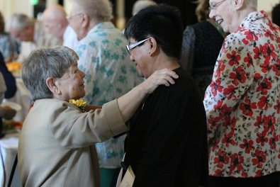 Golden Jubilarian Sister Cathy Campbell is congratulated by Sister Evelyn Ovalles after the ceremony.
