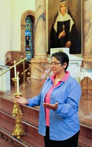 Sister Joni Luna prays in 2-14 as she becomes a novice with the Sisters of Providence.