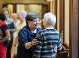 Sister Janice Ostrowski excitedly greets a sister she has not seen in a while. (photo by Amy Miranda)