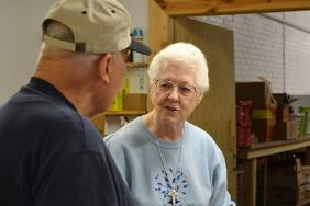 """Providence Food Pantry director Sister Joseph Fillenwarth with a pantry volunteer. Saint Mary's Village Parish's fifth """"Hunger Bust Fun Run/Walk"""" will take place at 10 a.m., on Saturday, Sept. 10. All proceeds from the event will benefit the food pantry."""