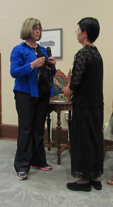 Novice Director Sister Janice Smith presents the historical chaplet to Sister Anna.