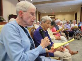 Sisters pray during the blessing: from left Sisters Ellen Cunningham and Rita Clare Gerardot.