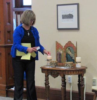 Novice Director Sister Janice Smith lights the candles at the beginning of the blessing ceremony.