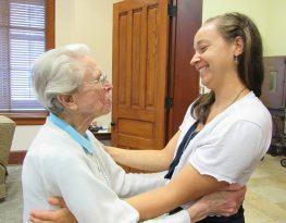 Sister Bernadette Mary Carroll congratulates Sister Tracey.