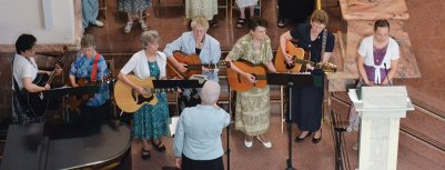 The four college friends were making music together still this summer at a Mass. Sister Lisa directs the group as, from left, Sisters Dina Bato, Patty Wallace, Jeanne Hagelskamp, Jenny Howard, Pam Pauloski and Dawn Tomaszewski play guitar. Sister Tracey Horan sings at right.