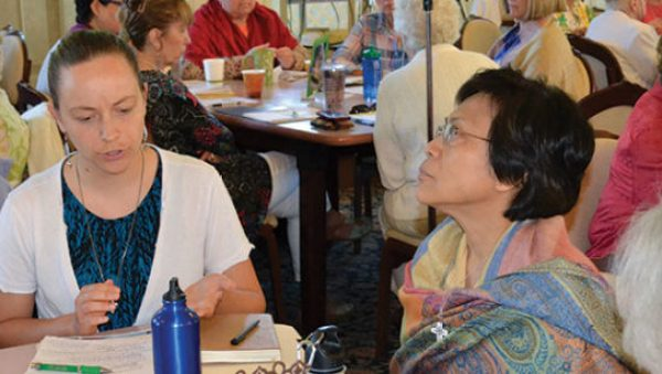 Doing the work of Chapter: Sisters Tracey Horan and Editha Ben discuss justice issues.