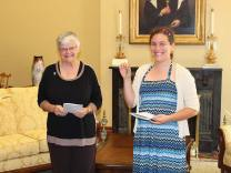 Emily, shown here with General Superior Sister Denise Wilkinson, shows off the keys to her new home in the formation community at Saint Mary-of-the-Woods.
