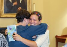 Emily gets a hug of congratulation from her discernment guide Sister Carole Kimes, whom she has been meeting with regularly over the past year.