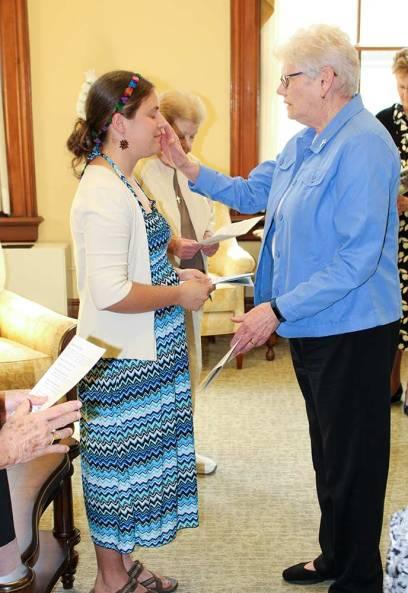Vicar/ General Officer Sister Lisa Stallings blesses Emily during the prayer service.