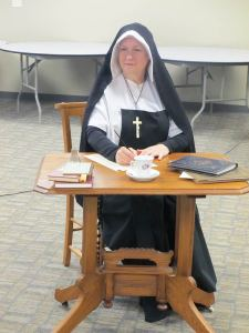 Providence Associate Sandra Hartlieb performs as Saint Mother Theodore Guerin Oct. 10 at St Simon Parish in Indianapolis.