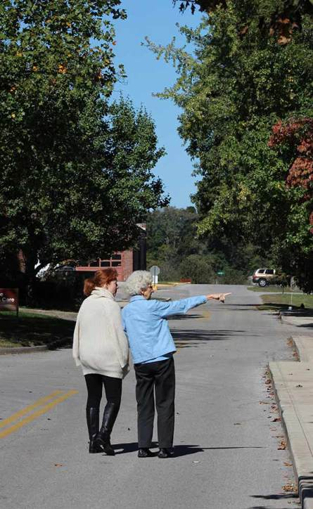 Sister Dorothy Rasche, right, points something out to her Providence Associate Candidate Julie Mansard during a walk.