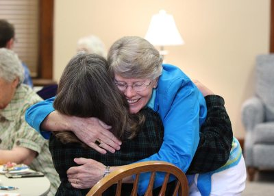 Sister Mary Montgomery pops in during a break in the orientation to greet her sister-in-law, Candidate Cindy Montgomery.