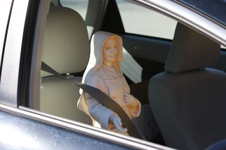 Saint Mother Theodore sets a good example by wearing her seat belt on the way back from the meeting.