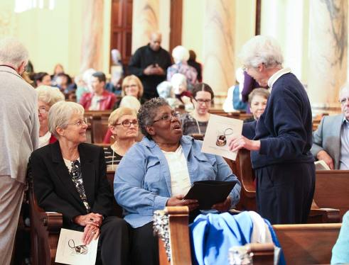 New associate Sandra Wickware visits with Sister Rosemary Schmalz before the ceremony. Her sister companion Sister Jackie Hoffman is seated at left.
