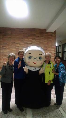 "Sister Jeanne Hagelskamp, Sister Dawn Tomaszewski, Sister Jenny Howard and Sister Norene Wu with character ""Peace."""
