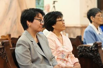 Sister Dina Bato, who is making perpetual vows, listens to Sister Dawn's reflection.