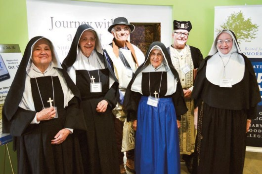 Sister Rosemary Nudd as Saint Mother Theodore Guerin (from left), Sister Ann Casper as Sister Mary Cecilia Bailly, Carl Bender as Joseph Thralls, Sister Rita Clare Gerardot as Sister Olympiade Boyer, Providence AssociateCharles Fischer as Father Buteux and Sister Martha Wessel as Mother Mary Cleophas Foley.