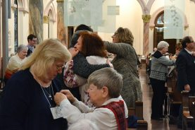 Sister Cathy Campbell pins the Providence Associate cross on Gail Smith
