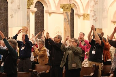 Blog post author Sister Paula Damiano, front right, joins Providence Associates and Sisters of Providence in an active prayer.