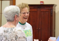 Providence Associate Donna Watzke laughs while visiting with sisters and associates at the retreat.
