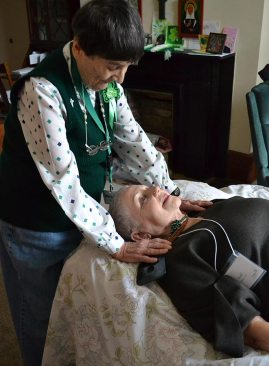 Sister Mary Lou Ruck offers a healing energy session for Providence Associate Gail Jones