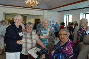 Catching up with each other are, from left, Sisters Susan Dinnin, Mary Jeanine Schubert, Mary Catherine Guiler and Peggy Lynch.