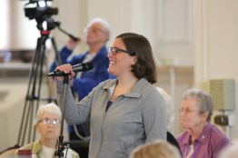Novice Sister Emily TeKolste shares from the microphone.