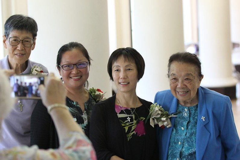 Sisters of Providence originating from Asia spoke to Providence Associates about the Sisters of Providence mission in Asia on Saturday morning. Here a Providence Associate takes a photo of four of the sisters after the talk. From left, Sisters Delan Ma, Teresa Kang, Anji Fan and Donna Marie Fu.