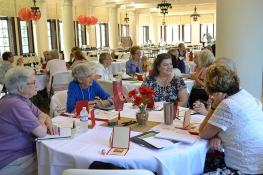 Listening during table discussion are from left, Providence Associates Lorraine Kirker, Marilyn Webb and Kim Knoblock.