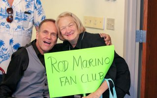 Providence Associate Christine Boyle, self-proclaimed president of the Rod Marino fan club, poses with Rod after his performance for the sisters and associates Sunday evening.