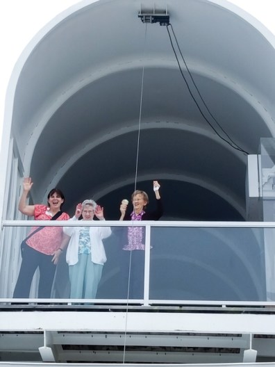 Katie Harich and Sisters Mary Lois Hennel and Theresa Clare Carr wave down from inside the world's largest mailbox in Casey, Illinois.