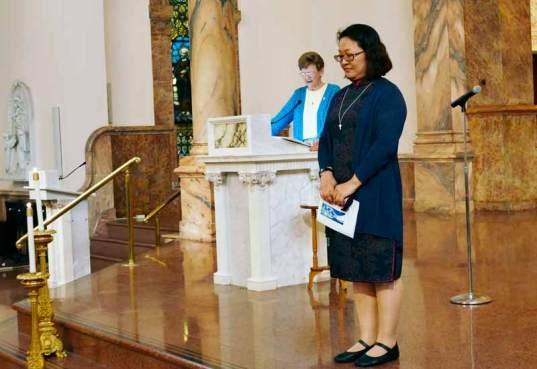 All those gathered pray for the new novice Sister Teresa Kang