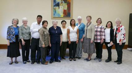 Posing after the entrance ceremony are, from left: Sisters Jeanne Hagelskamp, Marsha Speth, Mr. and Mrs. Vitente, Sisters Jeanette Lucinio and Editha Ben, new postulant, Jessica Vitente, and Sisters Lisa Stallings, Dawn Tomaszewski, Janice Smith, Teresa Kang and Jenny Howard.