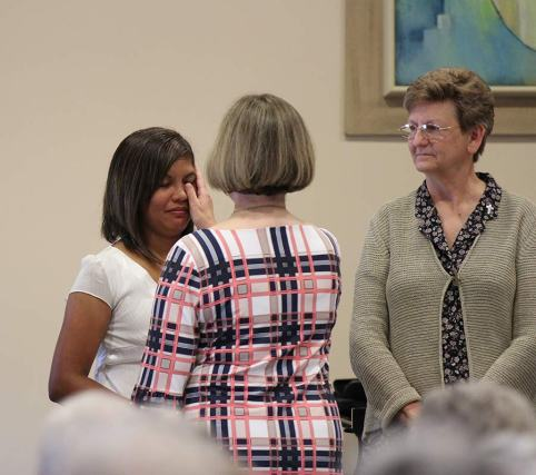 Sister Janice Smith blesses Jessica on her eyes during the entrance ceremony.
