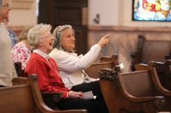 Sister Marilyn Herber and her candidate companion Karen Maynard enjoy their time together before the blessing ceremony.