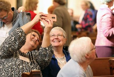 New Providence Associate Carri O'Donnell and her companion Joan Townsend take a selfie before the liturgy.