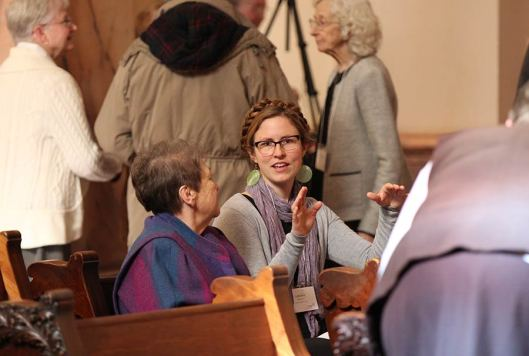 Candace Minster chats with her companion Sister Ann Sullivan before the liturgy.