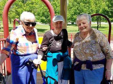 Sisters (from left) Suzanne Buthod, Ann Stephen Stouffer and Teresa Costello enjoy their time at the Deming Park playground as one of the many trips the HOME Team has taken sisters and others recently.