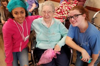 Sister Laurine Haley with two volunteers