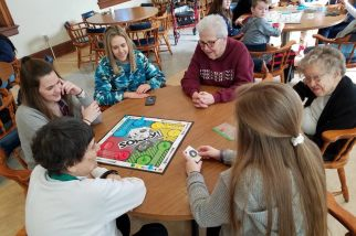 Sisters Mary Lou Ruck, Ann Casper and Francis Edwards play Sorry! with the teens