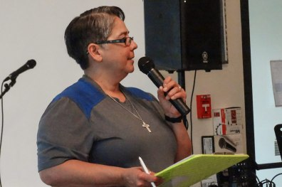 Sister Joni Luna, organizer of the teen ministry, speaks to those gathered.