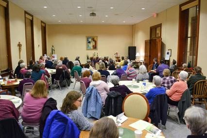 Sister Dianne presents to a full room of more than 80 Providence Associates, Sisters of Providence and guests.