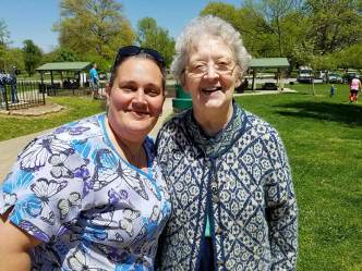 Sister Barbara Doherty (right) with a Providence Health Care nurse during an outing at Deming Park in Terre Haute.