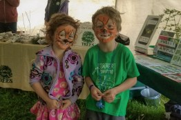 Brother and sister twinned with their tiger face paintings.